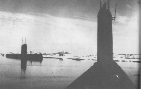 """Seadragon (SSN-584), foreground, and her sister Skate (SSN-578) during a rendezvous at the North Pole in August 1962. Note the men on the ice beyond the submarines"""