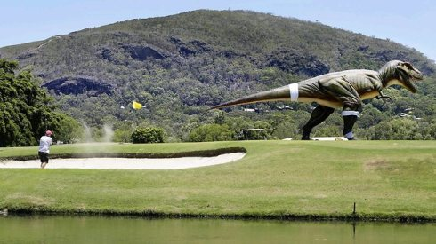 COURSE HAZARD: Clive Palmer's dinosaur on the golf course at Coolum. Source: The Courier-Mail