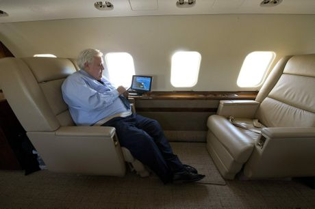 Palmer United Party (PUP) leader Clive Palmer uses his phone aboard his $70 million dollar Global Express aircraft in transit between Brisbane and Melbourne. (Dave Hunt/AAP)