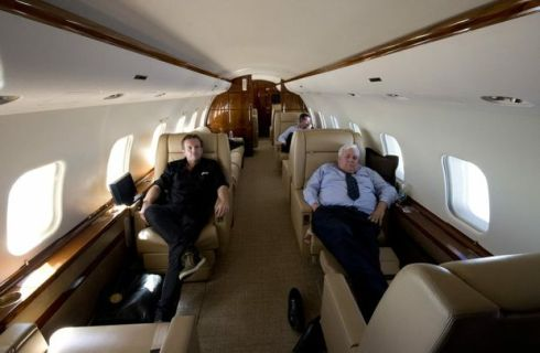 AAP Photographer Dave Hunt (left) travels with the Palmer United Party Leader mining magnate Clive Palmer, as he catches up on some sleep between campaigning, aboard his $70 million private jet, Wednesday, August 28, 2013. (AAP Image) (DAVE HUNT)