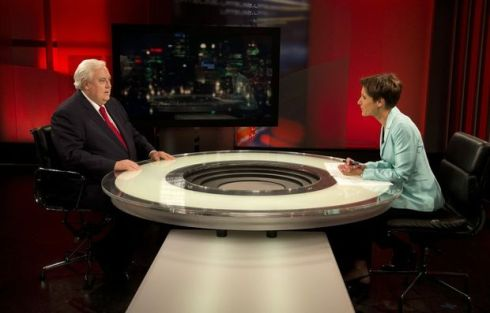 Palmer United Party (PUP) leader Clive Palmer (left) chats with ABC Television's Lateline presenter Emma Alberici prior to recording at ABC studios in Sydney. (DAVE HUNT)