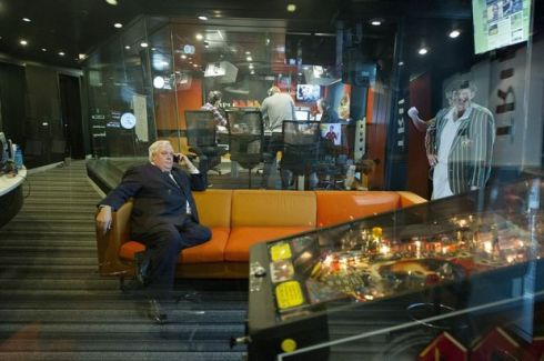 Palmer United Party leader Clive Palmer conducts an interview over the phone as he waits to do a breakfast radio interview on Triple M in Melbourne. (DAVE HUNT)